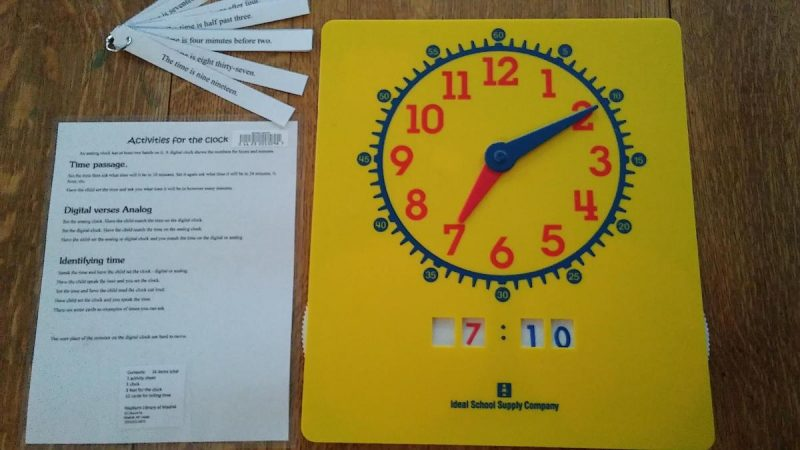 Clock analog and digital with activity sheet and time cards