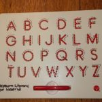Uppercase letters of the alphabet with magnetic pen