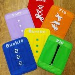 Zip, snap, button, buckle, lace, and tie boards